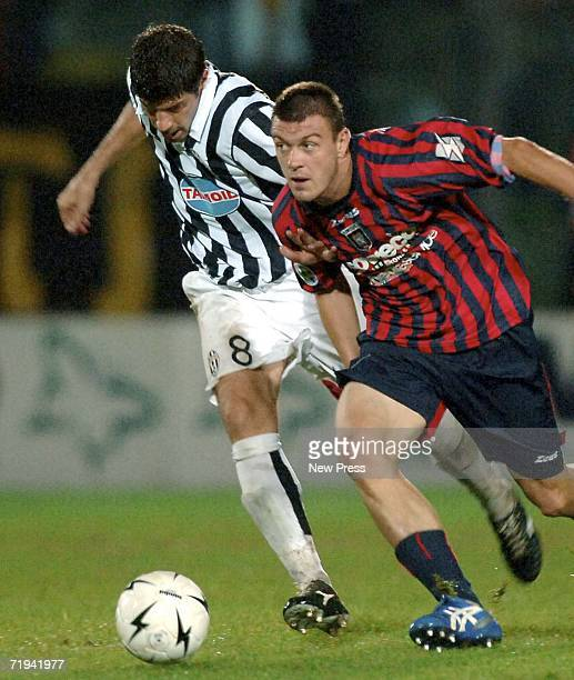 Guiliano Giannichedda of Juventus is challenged by Crotone during the Serie B match at Ezio Scida stadium September 19 2006 in Crotone Italy