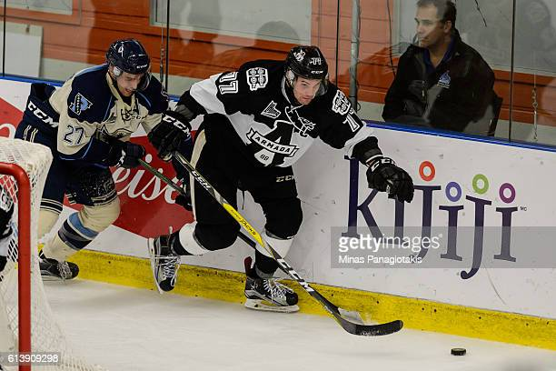 Guillaume Beaudoin of the BlainvilleBoisbriand Armada skates the puck against Julien Pelletier of the Sherbrooke Phoenix during the QMJHL game at the...