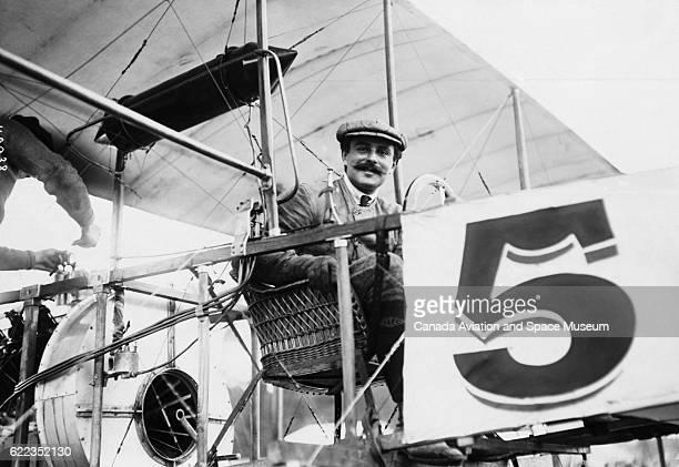Guillaume Busson sits in a biplane designed by WitzigLioreDutilleul during the 1909 Grande Quinzaine de Paris