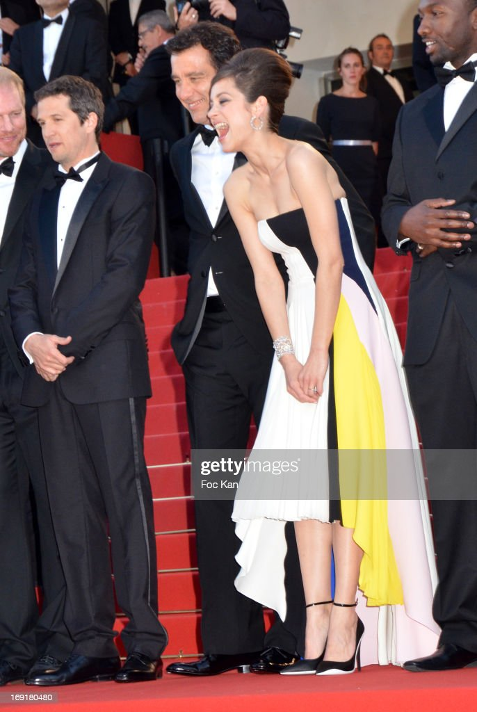 Guillaume Canet, actor Clive Owen and actress Marion Cotillard attend the Premiere of 'Blood Ties' during the 66th Annual Cannes Film Festival at the Palais des Festivals on May 20, 2013 in Cannes, France.