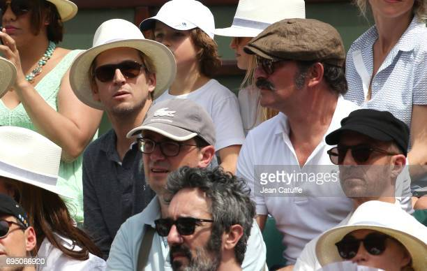 Guillaume Canet and Jean Dujardin attend the men's final on day 15 of the 2017 French Open second Grand Slam of the season at Roland Garros stadium...
