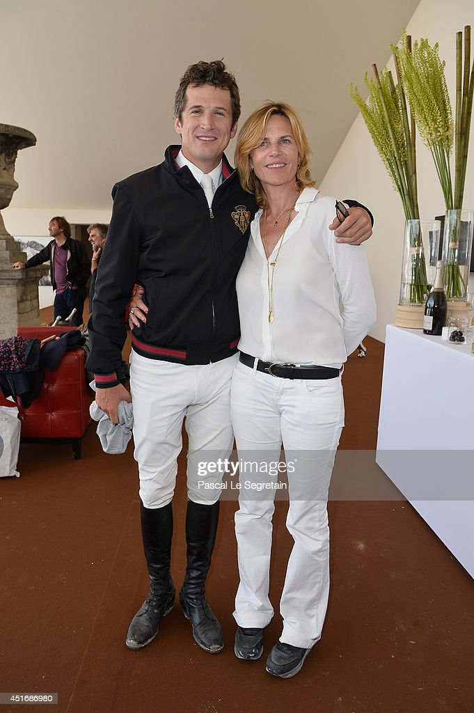 Guillaume Canet and Virginie CouperieEiffel attend the Paris Eiffel Jumping presented by Gucci at ChampdeMars on July 4 2014 in Paris France