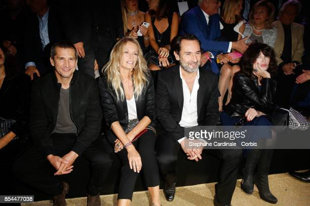 Guillaume Canet Estelle Lefebure Gilles Lellouche and Isabelle Adjani attend the Etam show as part of the Paris Fashion Week Womenswear Spring/Summer...