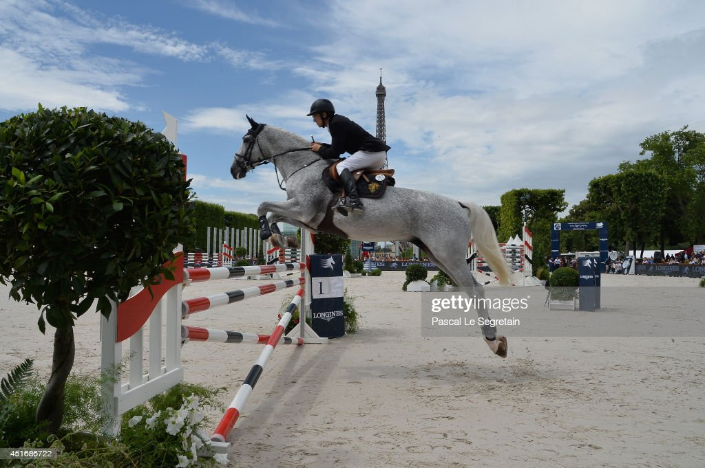 Guillaume Canet rides Jumping Star Callius during the Paris Eiffel Jumping presented by Gucci at Champ-de-Mars on July 4, 2014 in Paris, France.