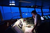 Guillaume Dalmard a Loire Pilot works in the bridge as he manoeuvres the Africa Four a container ship of French shipping company CMA CGM out of the...