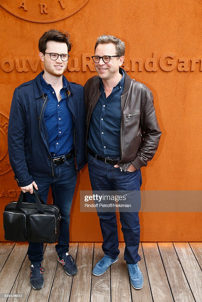 Guillaume de Tonquedec and his son attend the French Tennis Open Day Five at Roland Garros on May 26, 2016 in Paris, France.