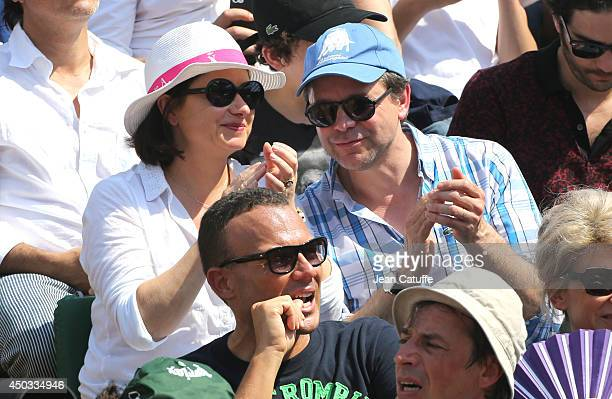 Guillaume de Tonquedec and his wife Christelle de Tonquedec attend the men's final of the French Open 2014 held at RolandGarros stadium on June 8...