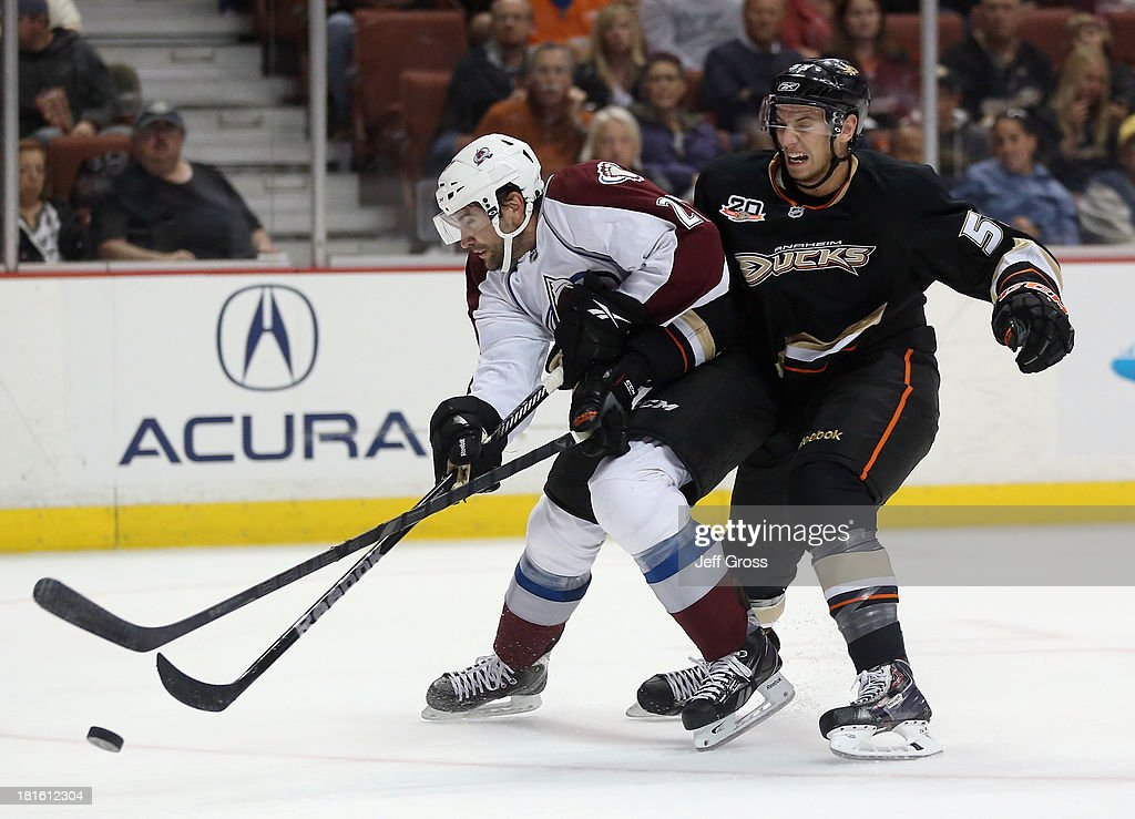 <a gi-track='captionPersonalityLinkClicked' href=/galleries/search?phrase=Guillaume+Desbiens&family=editorial&specificpeople=2278118 ng-click='$event.stopPropagation()'>Guillaume Desbiens</a> #27 of the Colorado Avalanche is pursued by <a gi-track='captionPersonalityLinkClicked' href=/galleries/search?phrase=Shea+Theodore&family=editorial&specificpeople=9860443 ng-click='$event.stopPropagation()'>Shea Theodore</a> #53 of the Anaheim Ducks for the puck in the second period at Honda Center on September 22, 2013 in Anaheim, California.