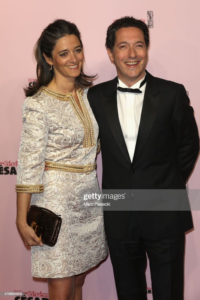 Guillaume Gallienne (R) and his wife Amandine arrive for the 39th Cesar Film Awards 2014 at Theatre du Chatelet on February 28, 2014 in Paris, France.