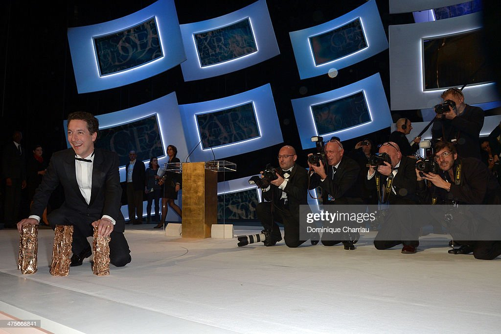 <a gi-track='captionPersonalityLinkClicked' href=/galleries/search?phrase=Guillaume+Gallienne&family=editorial&specificpeople=3280401 ng-click='$event.stopPropagation()'>Guillaume Gallienne</a> holds four winning Cesar awards on stage during the 39th Cesar Film Awards 2014 at Theatre du Chatelet on February 28, 2014 in Paris, France.