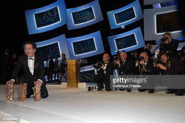 Guillaume Gallienne holds four winning Cesar awards on stage during the 39th Cesar Film Awards 2014 at Theatre du Chatelet on February 28 2014 in...