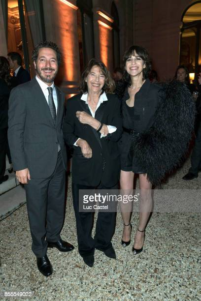 Guillaume Gallienne Jane Birkin and Charlotte Gainsbourg attend the Opening Party at Yves Saint Laurent Museum as part of the Paris Fashion Week...