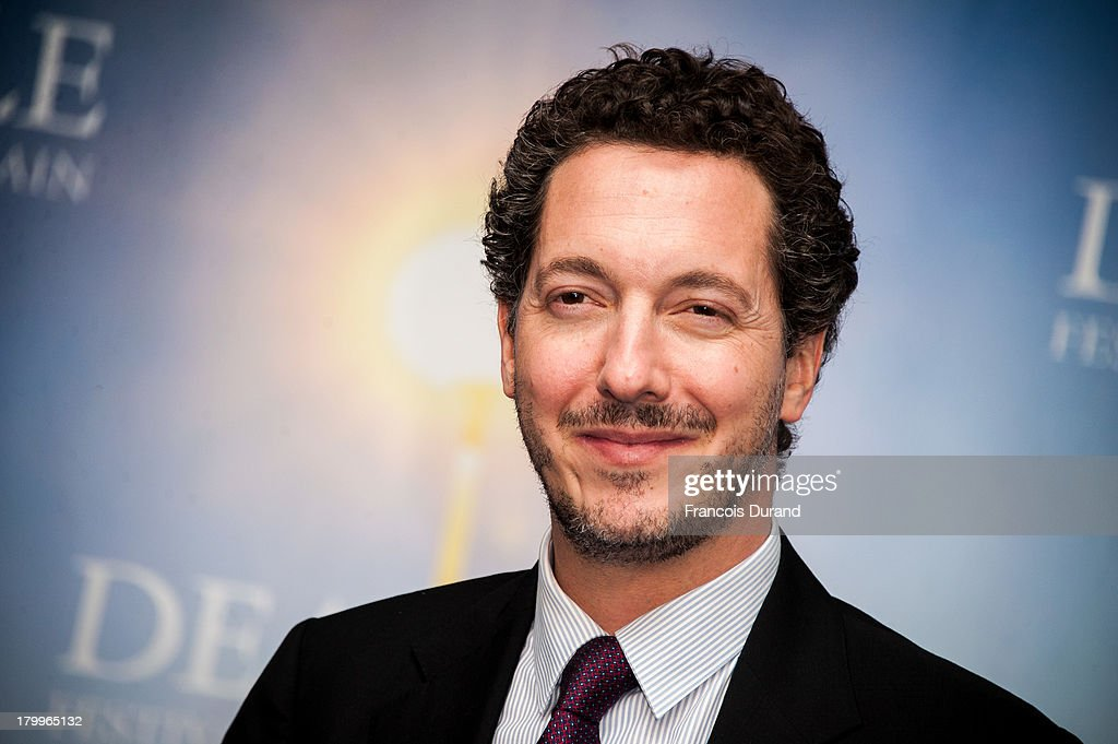 Guillaume Gallienne poses with his prize for the film 'Les Garons et Guillaume, table !' during the 39th Deauville American Film Festival on September 7, 2013 in Deauville, France.