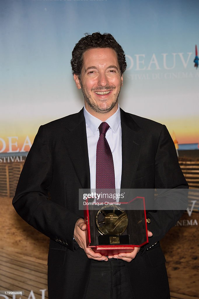 Guillaume Gallienne poses with the Michel d'Ornano Award he won with the film 'Me, myself and Mum' (Les Garçons et Guillaume à table !) on September 7, 2013 in Deauville, France.