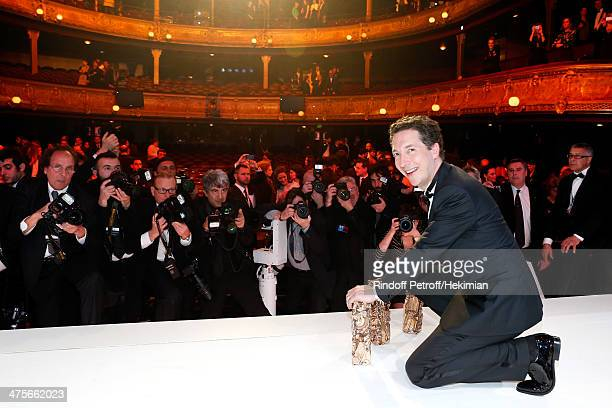 Guillaume Gallienne winner of the Best Actor Best First Film Best Adapted Screenplay and Best Film awards poses on stage after the 39th Cesar Film...