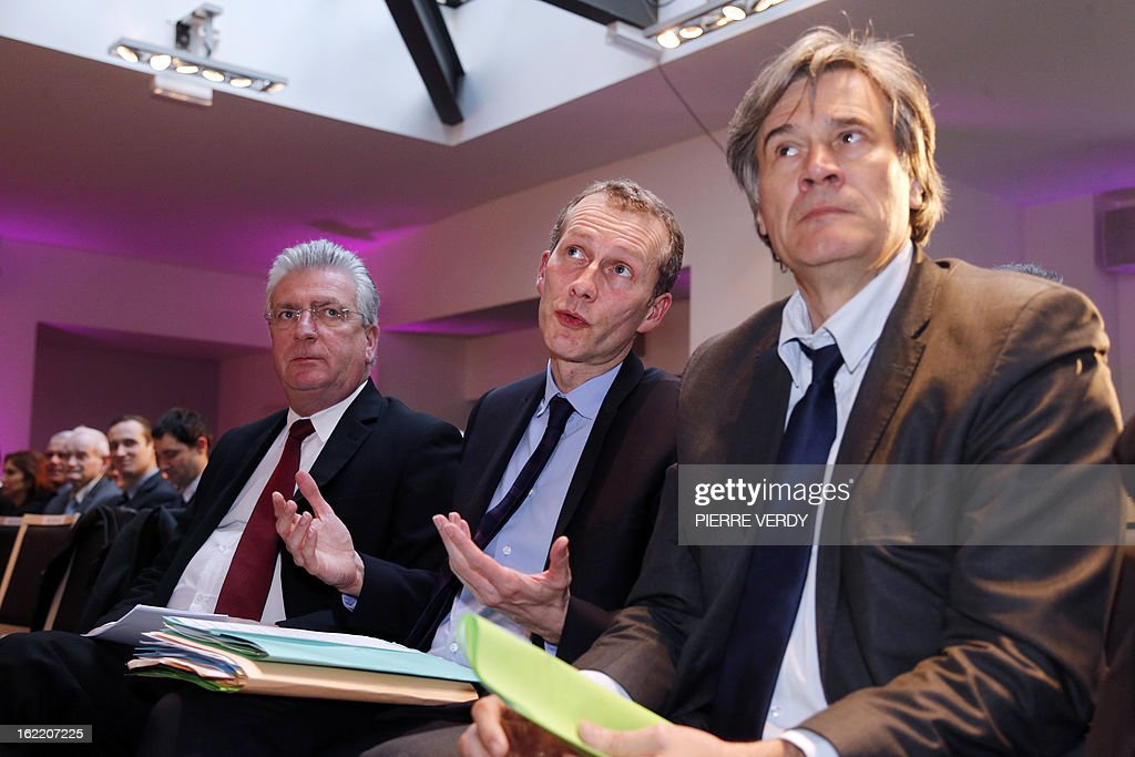 Guillaume Garot, Junior minister for Food Industry (C) speaks with Agriculture minister Stephane Le Foll (R) next to Head of the national association for meat and cattle (Interbev) Dominique Langlois during the plenary session of the first general assembly of the meat industry interbranch, on February 20, 2013 in Paris.