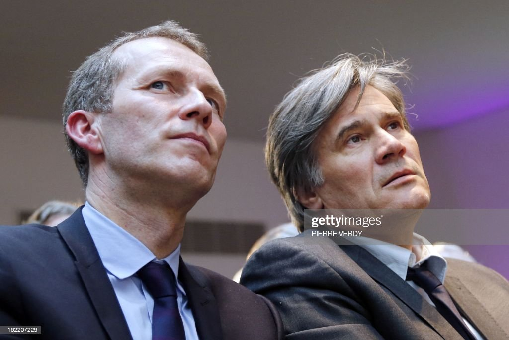 Guillaume Garot, Junior minister for Food Industry (L) speaks with Agriculture minister Stephane Le Foll during the plenary session of the first general assembly of the meat industry interbranch, on February 20, 2013 in Paris.