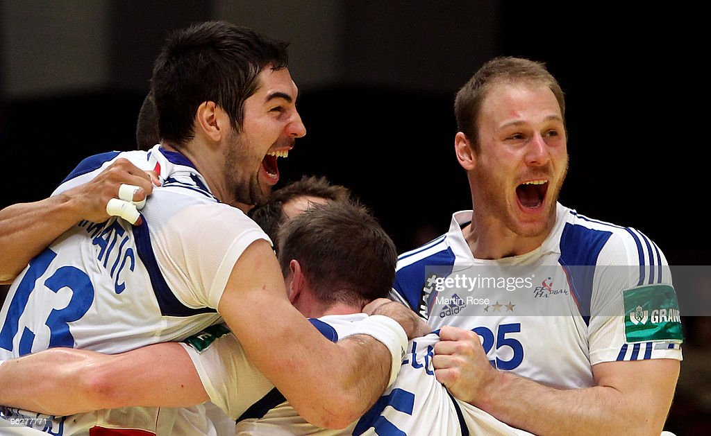 <a gi-track='captionPersonalityLinkClicked' href=/galleries/search?phrase=Guillaume+Gille&family=editorial&specificpeople=609796 ng-click='$event.stopPropagation()'>Guillaume Gille</a> (C) of France celebrates with team mate <a gi-track='captionPersonalityLinkClicked' href=/galleries/search?phrase=Nikola+Karabatic&family=editorial&specificpeople=620415 ng-click='$event.stopPropagation()'>Nikola Karabatic</a> (L) and Gregoire Detrez (#25) after the Men's Handball European semi final match between Iceland and France at the Stadthalle on January 30, 2010 in Vienna, Austria.