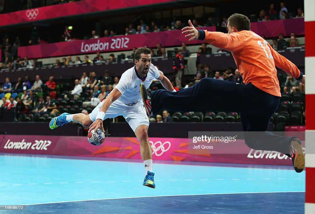 <a gi-track='captionPersonalityLinkClicked' href=/galleries/search?phrase=Guillaume+Gille&family=editorial&specificpeople=609796 ng-click='$event.stopPropagation()'>Guillaume Gille</a> of France jumps to shoot during the Men's Handball preliminaries group A match between France and Great Britain on Day 2 of the London 2012 Olympic Games at the Copper Box on July 29, 2012 in London, England.