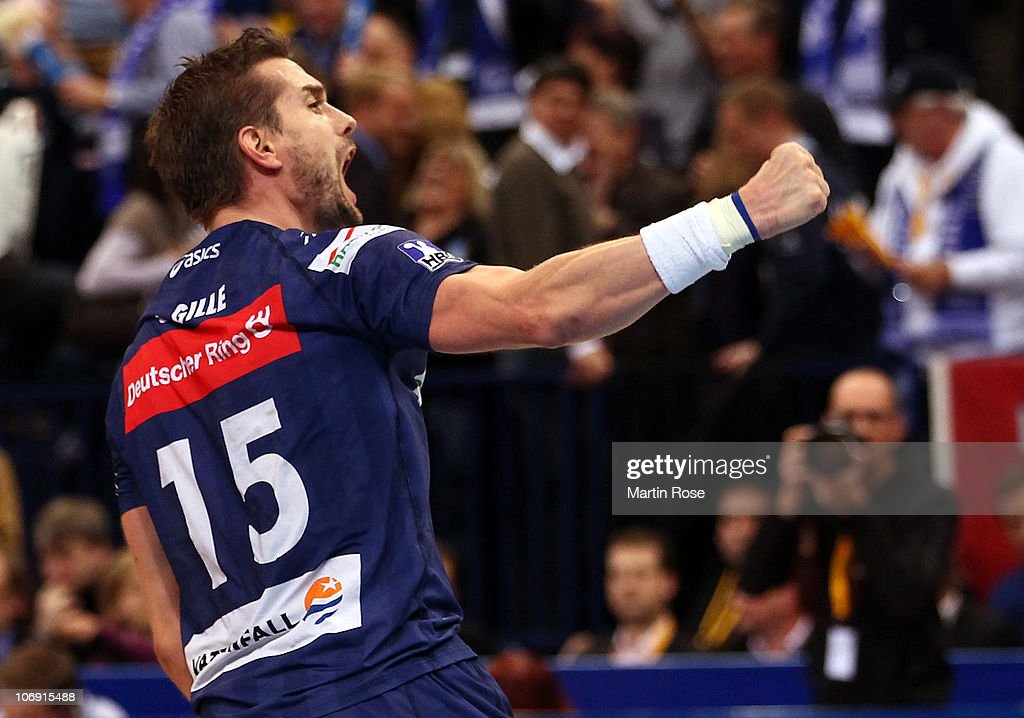 <a gi-track='captionPersonalityLinkClicked' href=/galleries/search?phrase=Guillaume+Gille&family=editorial&specificpeople=609796 ng-click='$event.stopPropagation()'>Guillaume Gille</a> of Hamburg celebrates after the Toyota Handball Bundesliga match between HSV Hamburg and THW Kiel at the o2 World Arena on November 16, 2010 in Hamburg, Germany.