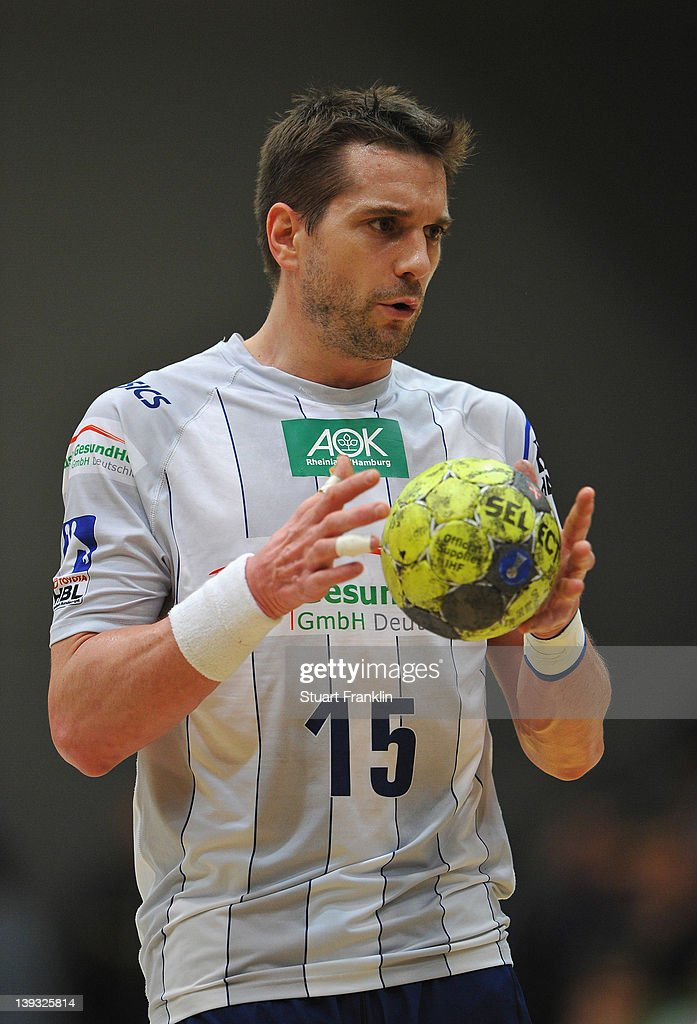 <a gi-track='captionPersonalityLinkClicked' href=/galleries/search?phrase=Guillaume+Gille&family=editorial&specificpeople=609796 ng-click='$event.stopPropagation()'>Guillaume Gille</a> of Hamburg in action during the Toyota Bundesliga match between Eintracht Hildesheim and HSV Hamburg at the Sparkasse Arena on February 19, 2012 in Hildesheim, Germany.
