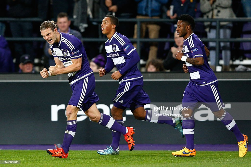 <a gi-track='captionPersonalityLinkClicked' href=/galleries/search?phrase=Guillaume+Gillet&family=editorial&specificpeople=4542498 ng-click='$event.stopPropagation()'>Guillaume Gillet</a> (L) of Anderlecht celebrates after scoring a goal to level the scores at 1-1 during the UEFA Europa League Group J match between RSC Anderlecht and Tottenham Hotspur FC at the Constant Vanden Stock Stadium on October 22, 2015 in Brussels, Belgium.