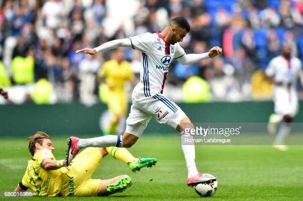 Guillaume Gillet of Nantes Rachid Ghezzal of Lyon during the Ligue 1 match between Olympique Lyonnais and Fc Nantes at Stade de Gerland on May 7 2017...
