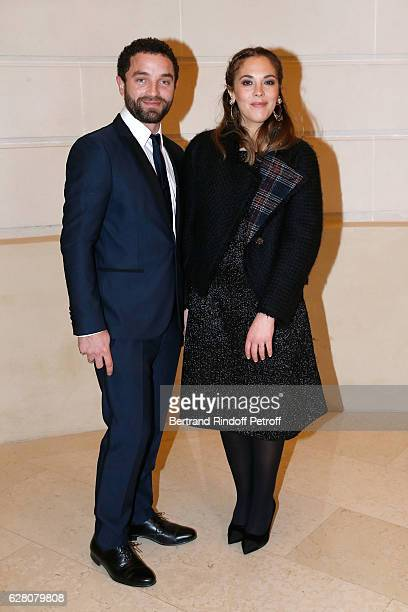 Guillaume Gouix and Alysson Paradis attends the 'Chanel Collection des Metiers d'Art 2016/17 Paris Cosmopolite' Photocall at Hotel Ritz on December 6...