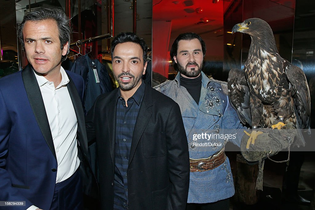 Guillaume Houze, Director of Sponsorship at Galeries Lafayette (L) and choreographer Kamel Ouali (C) attend the Galeries Lafayette 100th Anniversary Bal on December 12, 2012 in Paris, France.