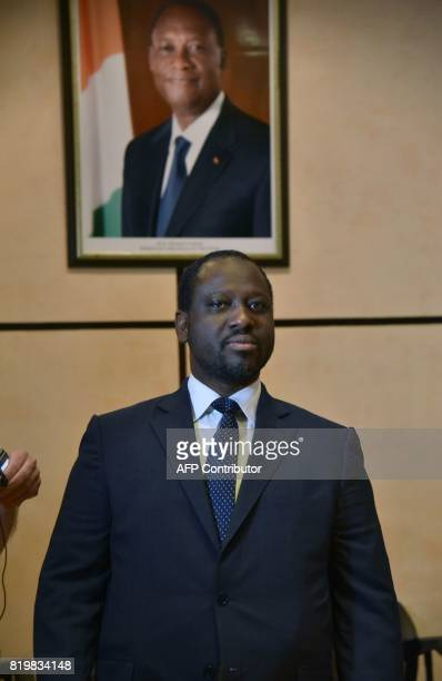 Guillaume Soro president of the Ivorian National Assembly stands before a poster of President Alassane Ouattara July 20 2017 at the Felix Houphouet...