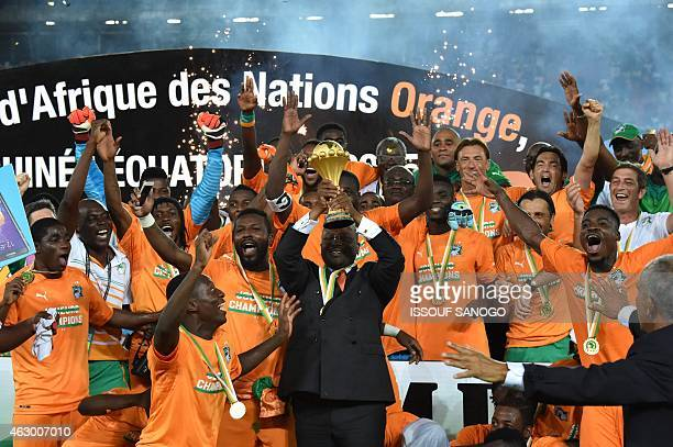 Guillaume Soro president of the Ivorian parliament raises the trophy at the end of the 2015 African Cup of Nations final football match between Ivory...