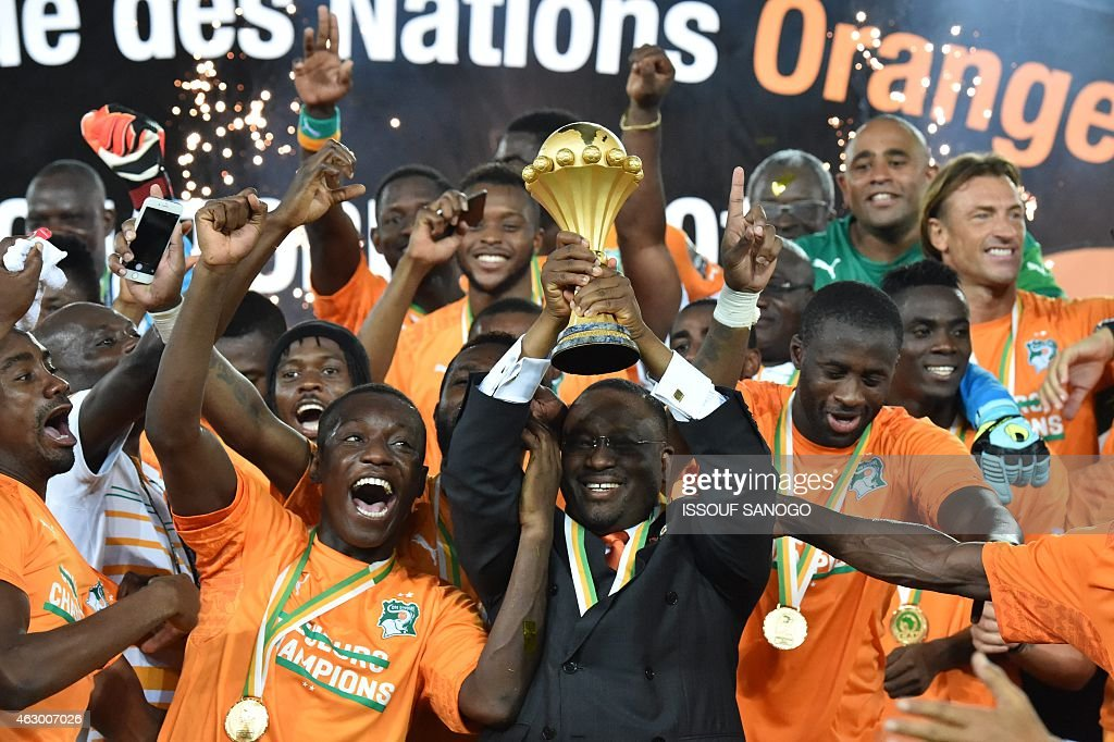 <a gi-track='captionPersonalityLinkClicked' href=/galleries/search?phrase=Guillaume+Soro&family=editorial&specificpeople=697567 ng-click='$event.stopPropagation()'>Guillaume Soro</a> (C) president of the Ivorian parliament raises the trophy at the end of the 2015 African Cup of Nations final football match between Ivory Coast and Ghana in Bata on February 8, 2015. Ivory Coast won 9 to 8 on penalties.
