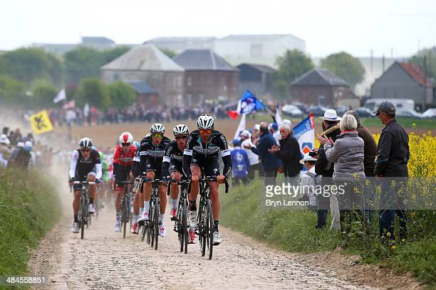 Guillaume van Keirsbulck of Belgium and Omega Pharma QuickStep leads the peloton over the first sector of cobbles during the 2014 Paris Roubaix race...