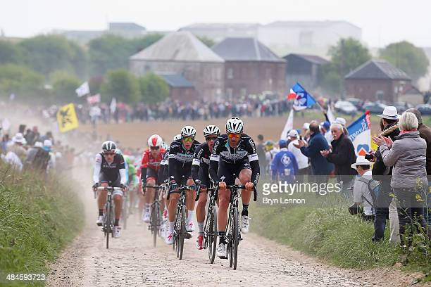Guillaume Van Keirsbulck of Belgium and Omega Pharma QuickStep leads the peloton on the first secteur of cobbles during the 112th edition of the...