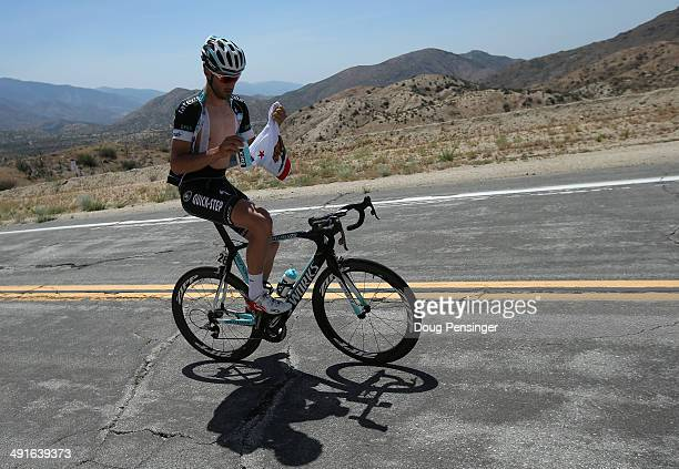 Guillaume Van Keirsbulck of Belgium riding for the Omega PharmaQuickstep Cycling Team collects the contents of his musette bag during stage six of...