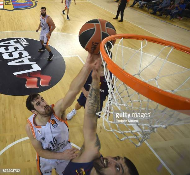 Guillem Vives #16 of Valencia Basket competes with Adrien Moerman #45 of FC Barcelona Lassa during the 2017/2018 Turkish Airlines EuroLeague Regular...