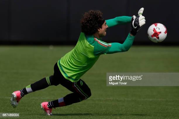 Guillemro Ochoa goalkeeper of Mexico dives for the ball during a training session at Centro Nacional de Desarrollo de Talento Deportivo y Alto...