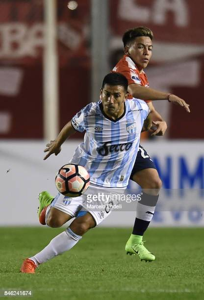 Guillermo Acosta of Atletico Tucuman fights for ball with Ezequiel Barco of Independiente during a second leg match between Independiente and...