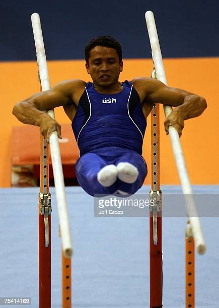 Guillermo Alvarez competes in the Parallel Bars at the Men's Artistic Gymnastics Team Final and Individual Qualification during the 2007 Pan American...