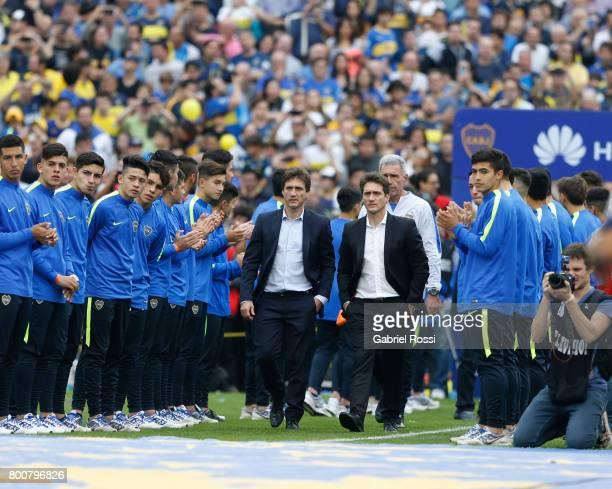 Guillermo Barros Schelotto coach of Boca Juniors and assistant Gustavo Barros Schelotto walk onto the field prior a match between Boca Juniors and...