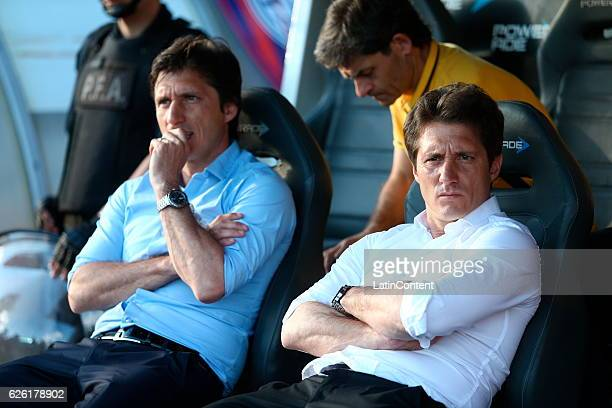 Guillermo Barros Schelotto coach of Boca Juniors and Gustavo Barros Schelotto watch the game during a match between Boca Juniors and San Lorenzo as...