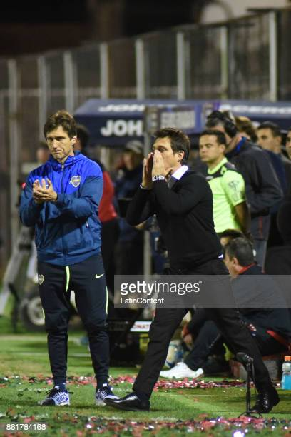 Guillermo Barros Schelotto coach of Boca Juniors and his assistant Gustavo Barros Schelotto give instructions to his players during a match between...