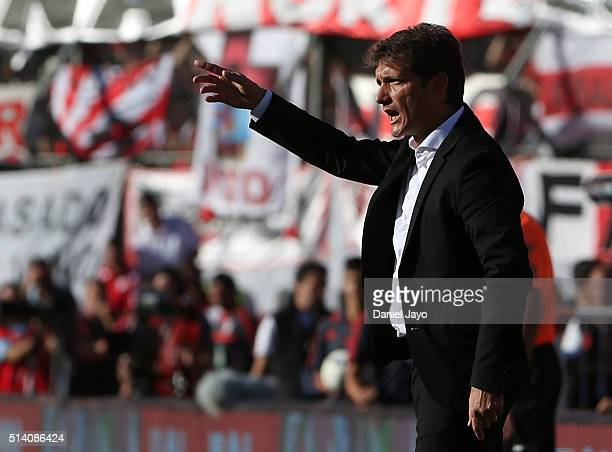 Guillermo Barros Schelotto coach of Boca Juniors gives directions to his players during a match between River Plate and Boca Juniors as part of sixth...