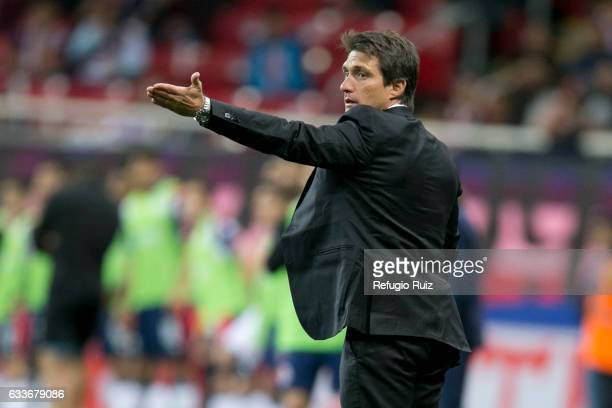 Guillermo Barros Schelotto coach of Boca Juniors gives instructions to his players during a friendly match between Chivas and Boca Juniors at Chivas...