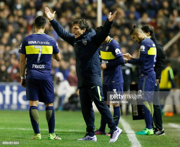 Guillermo Barros Schelotto coach of Boca Juniors gives instructions to Cristian Pavon of Boca Juniors during a match between Olimpo and Boca Juniors...