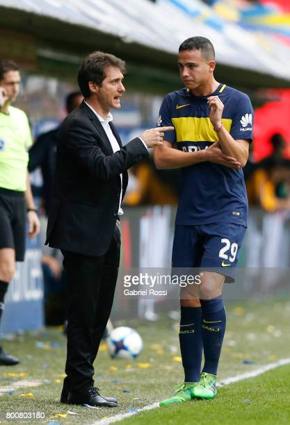 Guillermo Barros Schelotto coach of Boca Juniors gives instructions to his player Leonardo Jara during a match between Boca Juniors and Union as part...