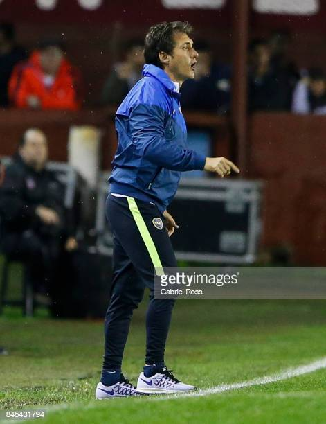 Guillermo Barros Schelotto coach of Boca Juniors gives instructions to his players during a match between Lanus and Boca Juniors as part of the...