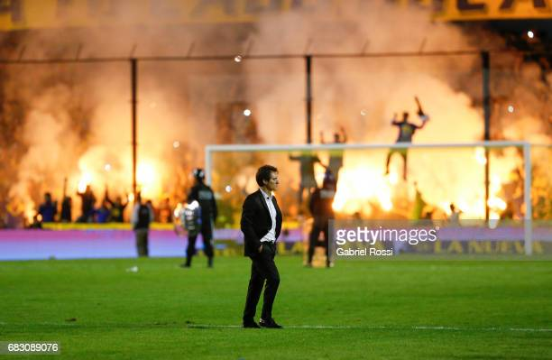Guillermo Barros Schelotto coach of Boca Juniors leaves the field after losing the match between Boca Juniors and River Plate as part of Torneo...