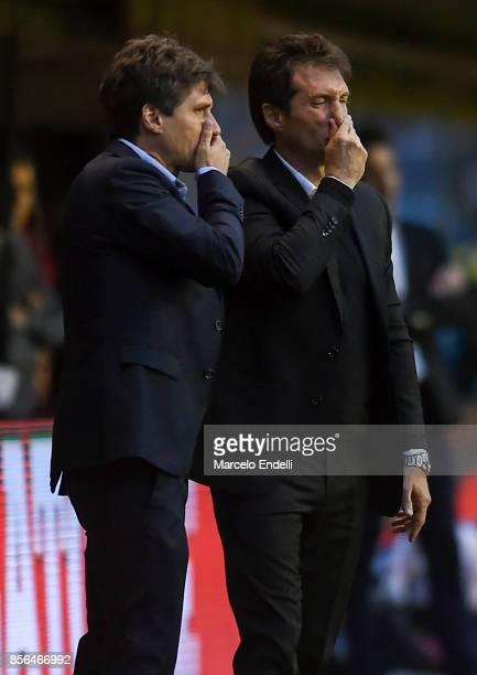 Guillermo Barros Schelotto coach of Boca Juniors talks with Gustavo Barros Schelotto during a match between Boca Juniors and Chacarita as part of...