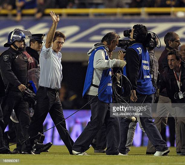 Guillermo Barros Schelotto former Boca Juniors' player and current Lanus' team coach waves before the Argentine First Division football match between...